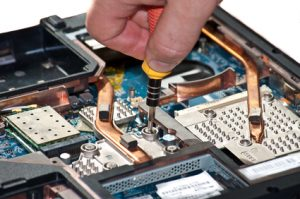 Laptop repair. The specialist conducts repairs laptop motherboard plans